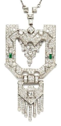 Art Deco platinum and diamond pendant necklace. Of geometric design, set with variously cut diamonds and emeralds, mounted in platinum.