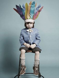 this makes me smile- little boy with indian headdress photographed on a simple backdrop