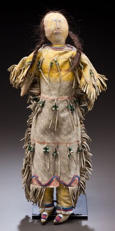 A CHEYENNE BEADED HIDE FEMALE DOLL. c. 1890... American Indian | Lot #50248 | Heritage Auctions