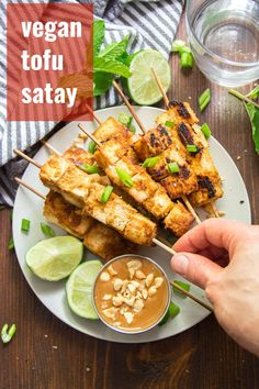 This flavor-packed vegan satay is made with skewered tofu cubes that are soaked in zesty lemongrass marinade, baked and served with luscious peanut dipping sauce! A delicious Thai inspired main dish that's easy to make and a crowd-pleaser! #tofurecipes #thairecipes #veganrecipes #satay Easy Vegan Dinner, Vegan Dinner Recipes, Delicious Vegan Recipes, Vegan Snacks, Vegan Lunches, Vegan Meals, Vegan Food, Vegetarian Recipes, Tofu Recipes