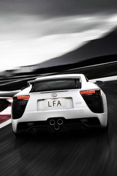 Lexus LFA  - the 2012 starts at $375,000 and features a 4.8L V10 engine that generates 552 hp with a 6-speed automated manual transmission. Ooooh weee!
