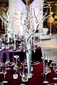 Spray-Painted Branches with Crystals - 17 Homemade Wedding Decorations for Couples on a Budget - EverAfterGuide
