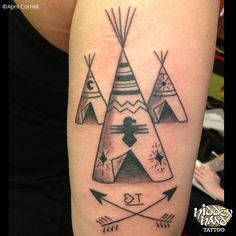 black and grey tattoo of three teepees and arrows