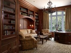 Designer Phyllis Harbinger added a sliding ladder allows for easy access to all the books in this masculine library.