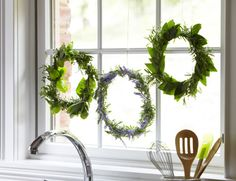 love, love, love!!! Fresh Herb Wreaths-Tie garden-fresh herbs to wire wreath forms for seriously darling decorations, favors and hostess gifts. Use herbs you—or your guest of honor—love, or try seasonal favorites like lavender, dill, tarragon, parsley and mint. Get the herb wreath how-to>>