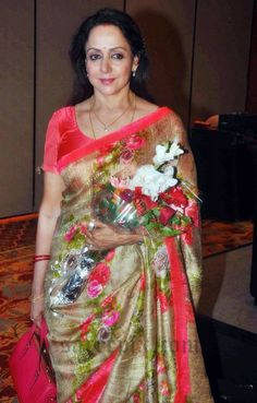 Ageless bolly beauty Hema malini in printed jute silk saree at the announcement of 2nd national Yash chopra memorial award. Neon short sleeves blouse.