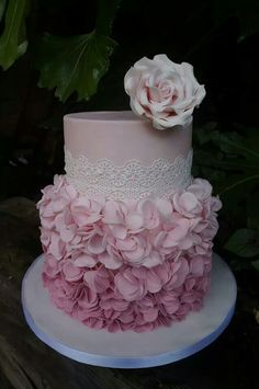 Soft pink ruffle cake with lace and rose