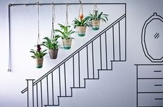Five hanging baskets clustered together along the stairway is a great way to bring greenery into your home.