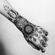 Beautiful mandala forearm tattoo. It almost seems like the arms have sprouted pretty flowers on its own and have ascended unto the arms.