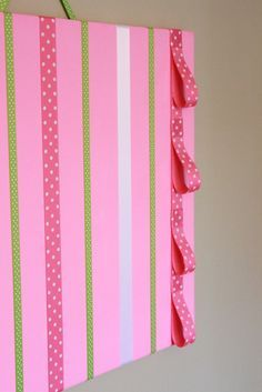 Would be so easy to make with ribbon and canvas-Hot Pink Hair Bow Holder Accessory Board w/ Headband Loops. $22.99, via Etsy.