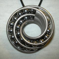 3ders.org - 3D printed metal - twin rail Mobius pendant with ball-bearings | 3D Printing news