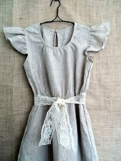 Vintage. Feminine. Modest. Blue. And lace. With a nice wool cardigan and some simple slip-ons, I'm fairly certain I could wear this dress every day of the week. Oh, if only I had $99 dollars to spend on a dress. Made by bayousalvage on Etsy.