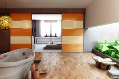 Bathroom sliding room dividers with beige and orange glass panels and anodised silver aluminium frame.
