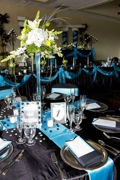 Turquoise runner, black table cloth, silver chargers (centerpiece?)