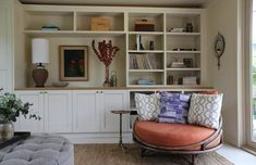 The custom cabinetry was designed by DISC and fabricated by To Do Something (it's painted in Benjamin Moore OC-12 Muslin); the Classic Cabinet K