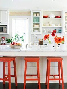 white kitchen orange stools dark wood floor bead board island light marble counters