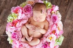 Love the flowers setup around baby :)