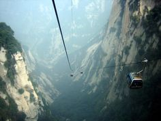 Heaven's Gate Stairs, Tianmen Shan, China - easy route up... Longest cable car ride. Can enjoy the 99 bends from it