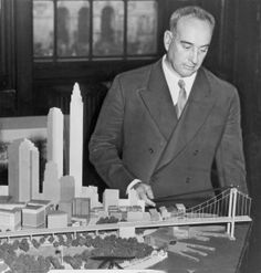 Robert Moses with his model for Battery Bridge