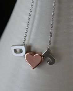 Hey, I found this really awesome Etsy listing at http://www.etsy.com/listing/165148556/tiny-silver-letter-and-rose-gold-heart