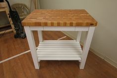 White Kitchen Cart with Butcher Block Cherry Top by McClure Tables.