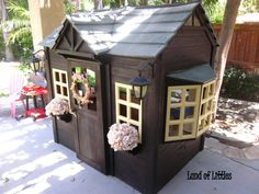 The playhouse we bought from Costco faded so I stained it, added flowers to the pots, and some cute solar lights-voila!
