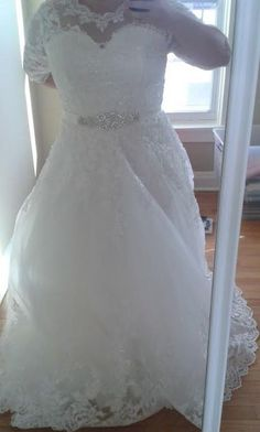 This lace wedding gown can be created for a bride of any shape or size.  We make custom #plussizeweddingdresses that are affordable.  We can also make inexpensive #replicaweddingdresses for you.  Get pricing on all kinds of #weddingdresses at www.dariuscordell.com/