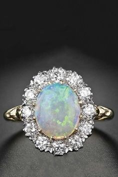 An Opal engagement ring would be sooo amazing! Opal halo ring, done in the Victorian style. gold, carat opal and 12 European cut diamonds, tcw, Bling Bling, Opal Jewelry, Fine Jewelry, Opal Rings, Gemstone Rings, Gold Rings, Vintage Engagement Rings, Oval Engagement, Opal Diamond Engagement Ring
