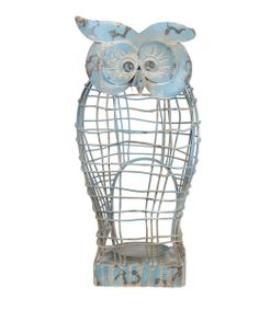 With a scented candle in the cage design, this owl-shaped holder illuminates décor with an eye-catching accent. The distressed finish is absolutely eye-catching