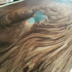 wood slab table with blue epoxy resin made by OSTROLUCKY