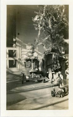 Vintage Christmas Photo ~ Small child with outdoor Christmas tree and toys.