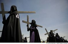 "Penitents take part in the ""San Bernardo"" brotherhood procession during the Holy Week in Sevilla on April 8, 2009. Christian believers around the world mark the Semana Santa (Holy Week) of Easter in celebration of the crucifixion and resurrection of Jesus Christ. Cristina Quicler, AFP/Getty Images"
