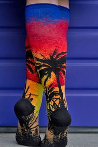 A gorgeous sunset, silhouetted palm trees, a beachy foreground on your feet-- these socks are a vacation getaway! Roll top cuffs and flat knit toe seams mean added comfort, perfect for paradise.