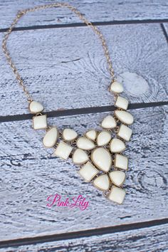 Gotta have.  It goes with so many of the beautiful georgous dresses. Gold and Ivory Necklace - The Pink Lily Boutique