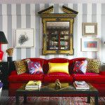 The wall stripes in the West Village living room were hand-painted. The custom velvet sofa is by Carlyle, with Samuel & Sons tape and bullion fringe, and the Empire-style gueridon came from 1stdibs. Flanking the sofa are garniture lamps by Christopher Spitzmiller. Photo by Maura McEvoy for House Beautiful