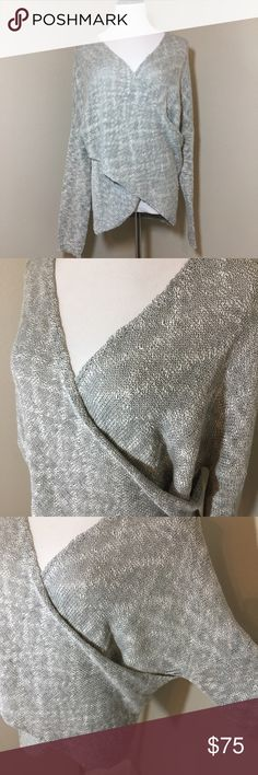 Grey Crossover Sweater Lightweight crossover sweater in a grey melange print. Sleeves are dolman style and the style is supposed to be a little slouching opposed to fitted. Slight Hi-low hem and v-neck openings. Only worn once and in excellent condition. Measurements only by request. Sweaters V-Necks