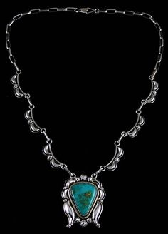 Ned Nez Easter Blue Turquoise Reposse Necklace #NedNez A brilliant Easter Blue turquoise is the center piece of this beautiful necklace created by Navajo artist Ned Nez. The natural gem is deep sky blue with hints of green an vibrant gold host rock matrix. Representing the finest quality from the mine, it sits in a hand made bezel surrounded with a beautiful reposse design. Each reposse is set between hand made droplets and stars.