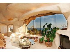 Why Dick Clark Built a Spot-On Flintstones House in Malibu - What It Sold For - Curbed LA