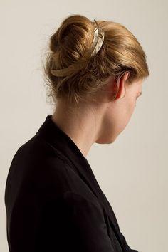 dress up an everyday bun with metal feather headpiece