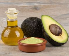 Mix the flesh of an avocado with olive oil until it creates a thick paste. Apply it to the lengths of your hair and leave it on for 30 minutes.