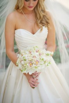 Orchid bouquet....<3 plus this sweetheart neckline, fitted bodess and ballgown are gorgeous
