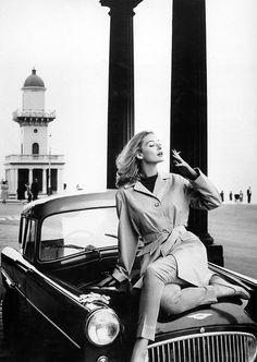 1960, Fenwick, Lancashire. Vogue. Model Tania Mallett wearing raincoat by Morcosia. Photo by Norman Parkinson (B1913-D1990)