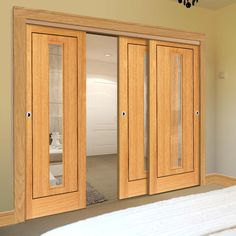 Thruslide Spencer Flush Oak 3 Sliding Doors and Frame Kit- Clear Glass - Prefinished - Lifestyle Image. Decor, Oak Doors, Doors, Sliding Doors, Oak, Clear Glass, Track Door, Timber Veneer, Sliding Room Dividers