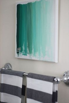 Creating ombre art is very simple. If you want something easy to make, just take a canvas, pick a color and trace lines with a paint brush while gradually diluting the paint with water.