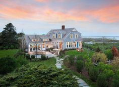 What could be a better spot to vacation than a waterfront cottage just a few minutes from town? Our Shearwater residence offers captivating 180-degree views of Nantucket Harbor. by inspirato