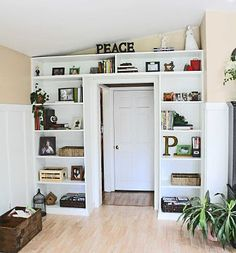 Small Space Storage Ideas: Surround a door with shelves. Use purchased units or cabinets to give the look of built-ins. Then run a shelf across the top from one side to the other to unite them. Or build them yourself with the help of this tutorial.