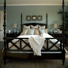 A contemporary style bedroom with blue paint, white trim and dark wood furniture. Click to get ideas and inspiration for your next bedroom makeover!