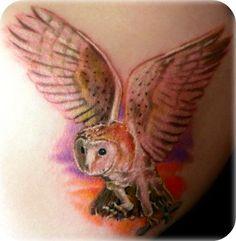 owl tattoo in flight landing