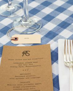 """With its """"RS"""" knot monogram, typewriter font, and kraft paper, the menu matched the rest of the stationery suite."""