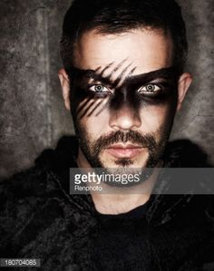 Very dark and mysterious mask makeup for a character who…